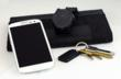 Smart keychain  triggers &#xA;actions on the mobile phone. Also a  great &#xA;companion to the Cookoo watch